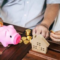 Elderly Couples talking about finance with piggy bank