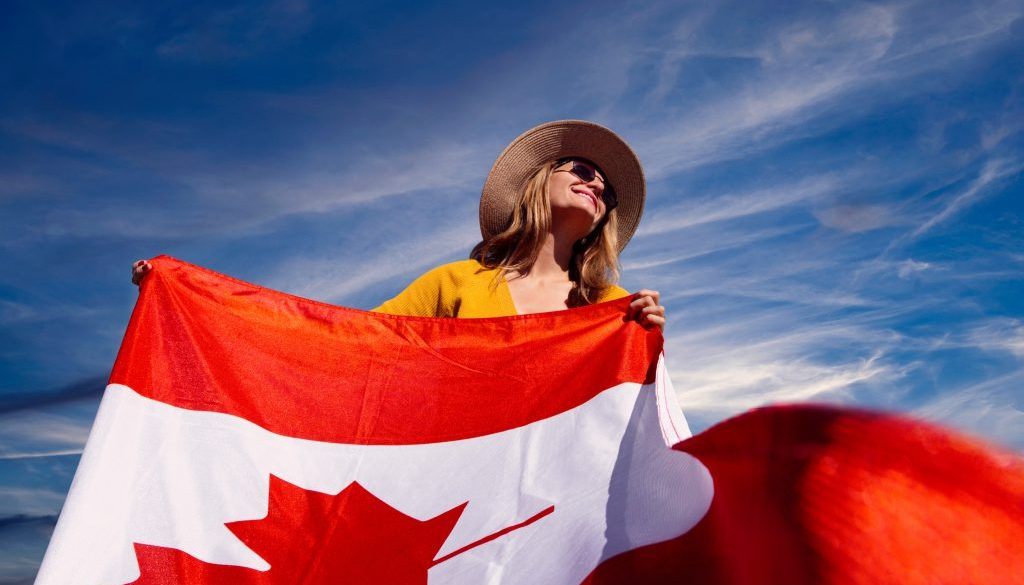 a-photograph-of-a-woman-holding-a-canadian-flag-2961063