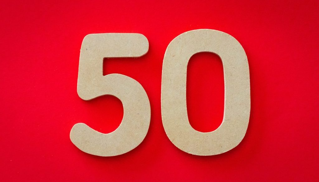 closeup-photo-of-50-against-red-background-1339866
