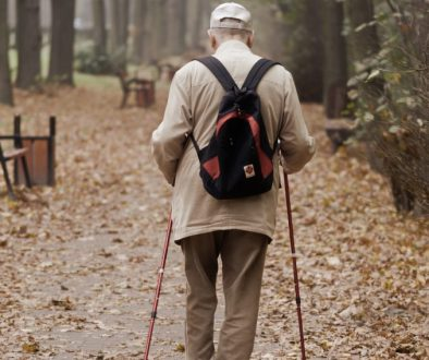 man-carrying-backpack-while-walking-on-a-paved-pathway-3149407