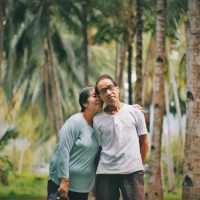 selective-focus-photo-of-old-couple-standing-together-with-2844982