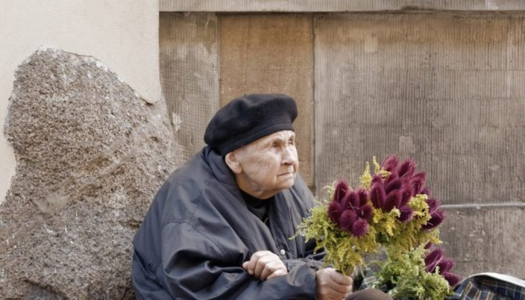 old-woman-holding-bouquet-of-flowers-3070675