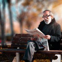 photo-of-man-reading-newspaper-1652340