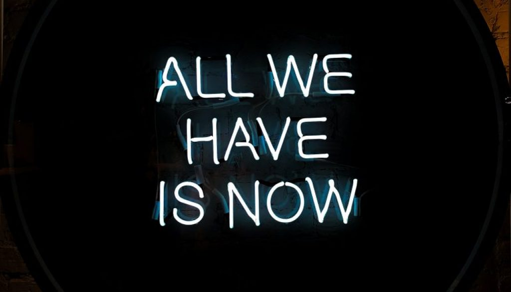 white-all-we-have-is-now-neon-signage-on-black-surface-1580625