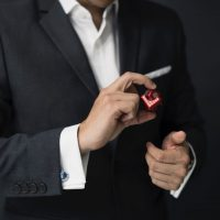 man-holding-red-cube-697675